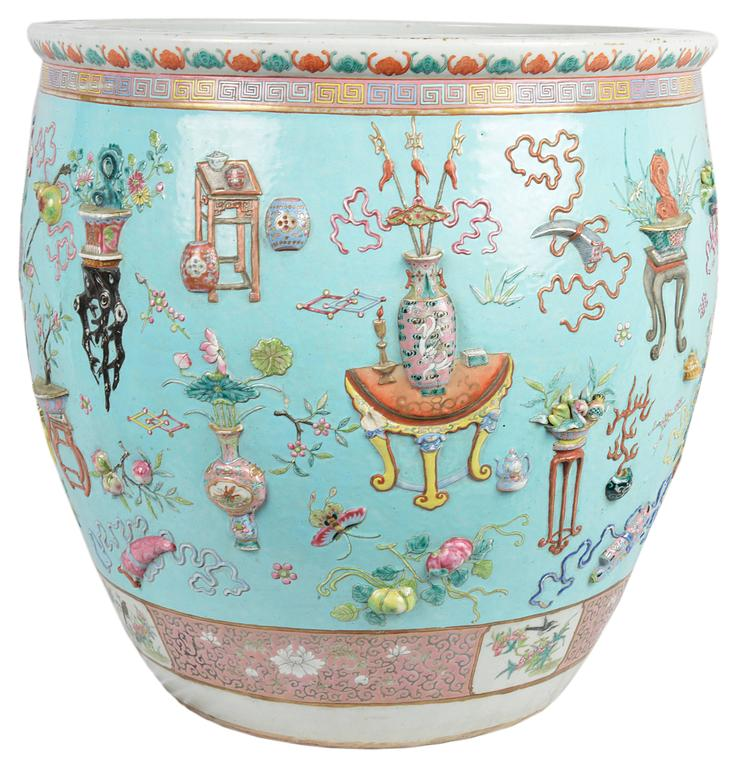 Very good quality 19th century Chinese Famille Rose fish bowl. Having a wonderful selection of raised, hand-painted vases, lanterns, furniture, flowers and motifs set on a turquoise back ground and a pink patterns boarder top and bottom. The