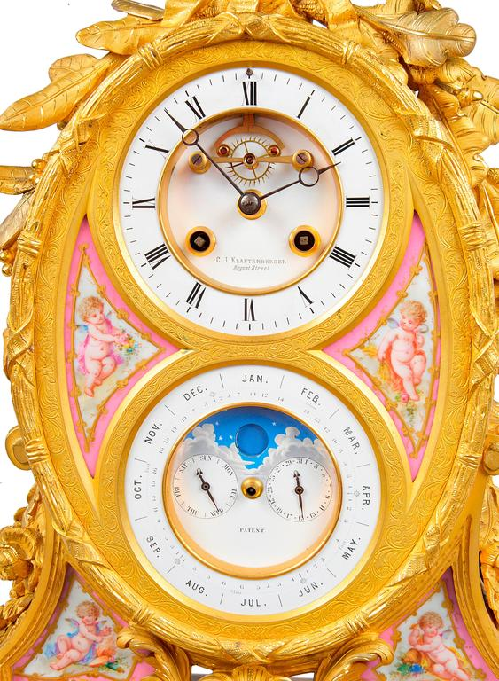 A very good quality French, 19th century gilded ormolu mantel clock with a calendar dial. Having pink Sevres porcelain panels. Foliate and ribbon decoration, the clock being an eight day movement and striking on the hour and half hour. 