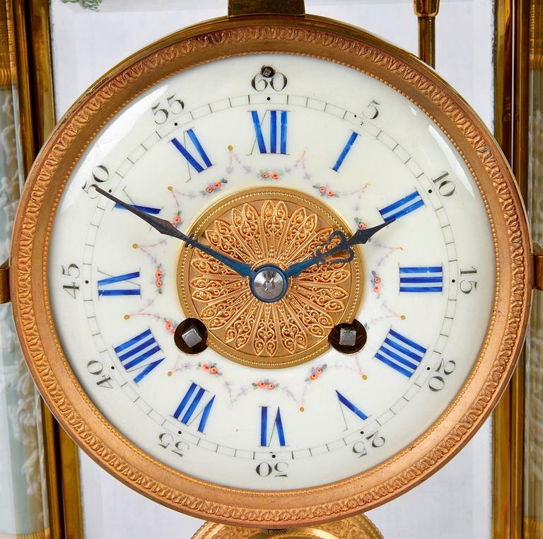 A good quality late 19th century gilded ormolu four glass mantel clock, having jasper re-leaf porcelain columns, pendulum and plaques. The enamel dial with roman numerals, an eight day movement with chiming to the hour and half hour.