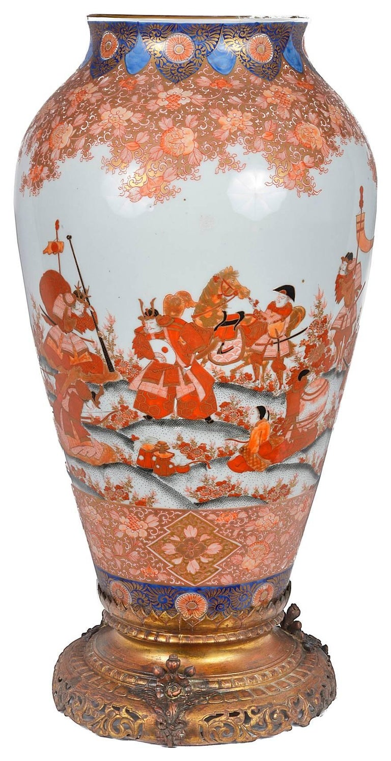 A very good quality, 19th century, Japanese Fukagawa porcelain vase or lamp. Having wonderful hand-painted scenes of Samurai warriors, some on horseback going to battle. Mounted on a gilded ormolu base. Wiring can be arranged.