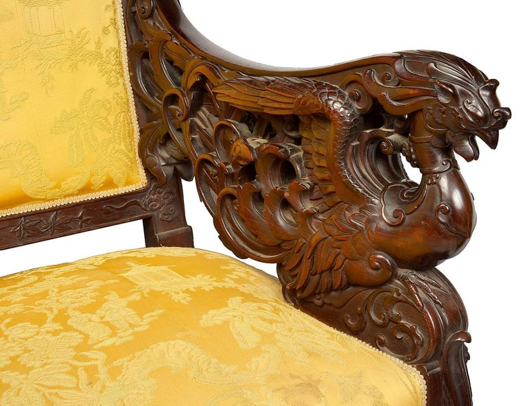 A beautiful 19th century Japanese sofa, having carved classical oriental foliate, floral decoration, with mythical dragons to the arms and raised on scrolling cabriole legs.