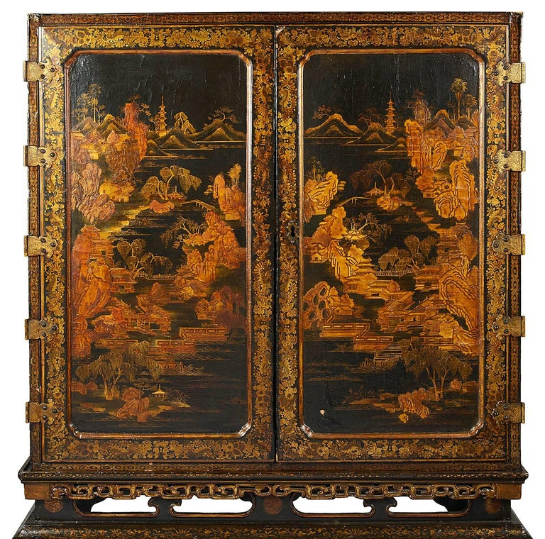 A wonderful quality 18th century Chinese export lacquer cabinet on stand. Having classical black lacquer and gilded Chinoiserie decoration. The pair of doors opening to reveal this spectacular fitted interior, with drawers, cupboards and
