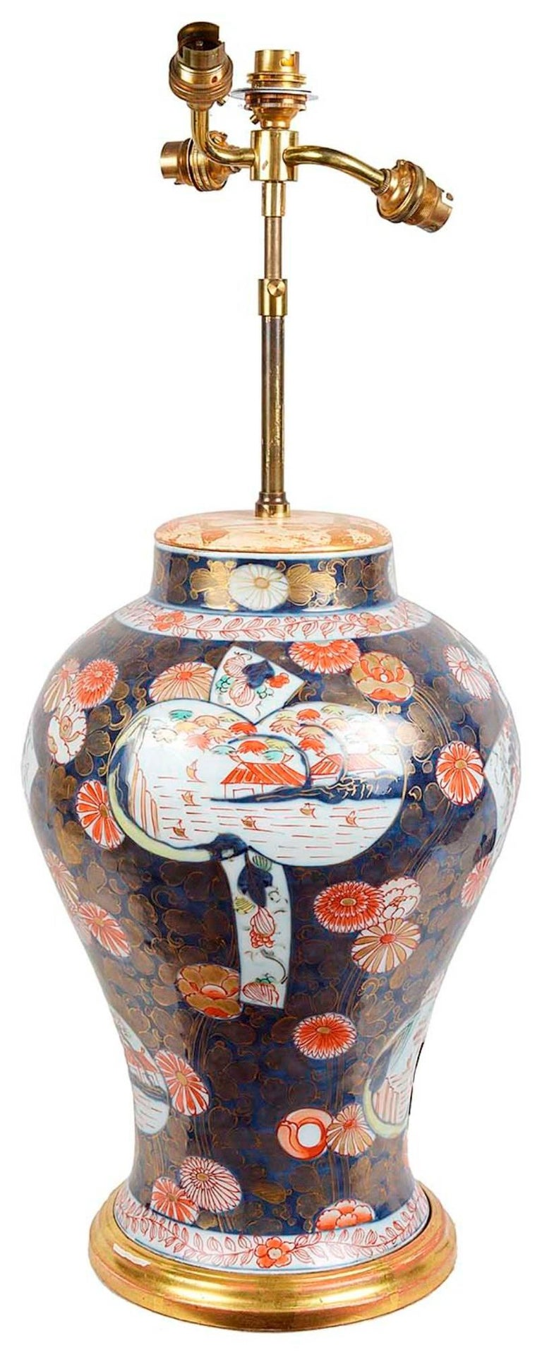 A very decorative 19th century Samson Imari bulbous vase, having classical blue and orange Imari colors. Depicting blossoms, leaves and panels with boats on a lake with buildings in the back ground.