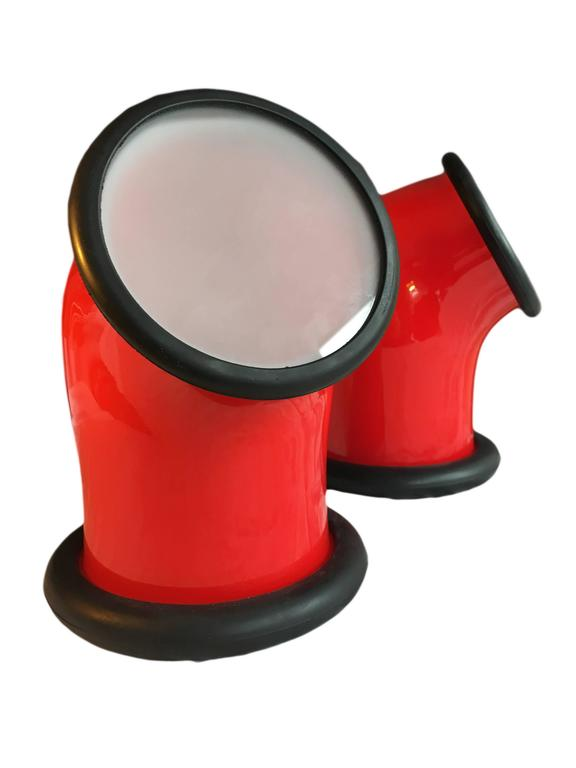 A pair of bright red Holmegaard glass Epoke 1 lamps. Designed by Michael Bang, Denmark, 1972.  Multipurpose usage - designed to be wired for wall/ceiling/bathroom or table lamp.  Unused items with original boxes. Several other models in stock.