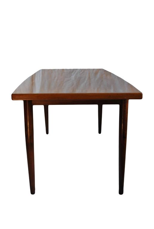 Subtlety tapered Brazilian rosewood coffee table. Produced in Denmark during the 1960s. Amazing grain and very high quality manufacture.