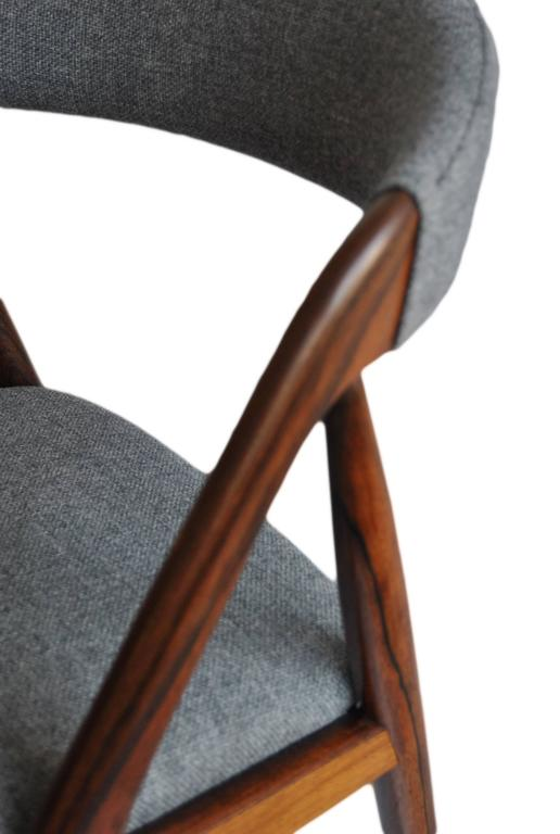 Kai Kristiansen Classic dining chairs in Brazilian rosewood with new Danish wool/cotton weave upholstery. Others available. 