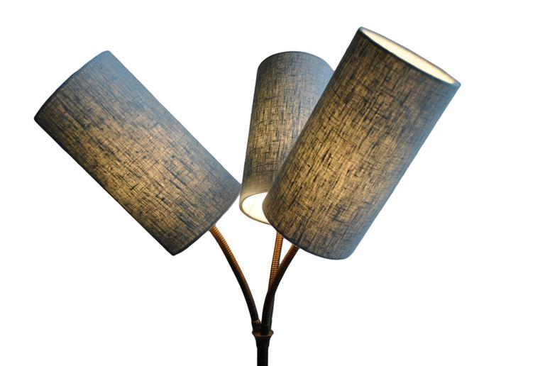 Very unusual tripod three headed floor lamp. Produced in Denmark circa 1960. Constructed in steel with brass angle-adjustable goosenecks and brass feet. This has been fully rewired and fitted with new fabric shades (other colour shades available).