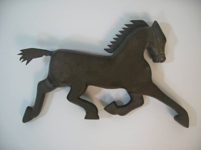 Wonderfully stylized figural Art Deco fragment of a prancing horse. Solid bronze, circa 1920-1930. Measure: 16.5
