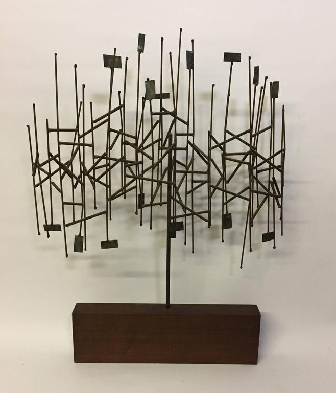 Wonderful mixed metals tree sculpture, circa 1960. Mounted on a walnut wood base. Reminiscent of Harry Bertoia's sculpture. The sculpture has been attributed to an Italian artist named Brazza who worked predominantly in the USA in the 1960s and