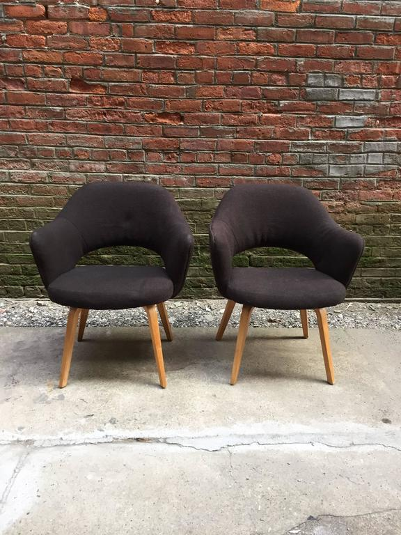 Bentwood laminate tapered legs with original black Knoll wool upholstery. The fabric and cushion are still in very good condition. The color is still very deep with very little fading due to light exposure. Some light stains and pile loss close to