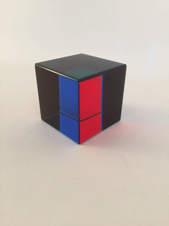 Op Art acrylic cube designed by Yugoslavian artist, Vasa Mihich. Signed and dated, Vasa 2000. Change the viewing angle, change the optical experience. The colors range from black, red, blue and teal.