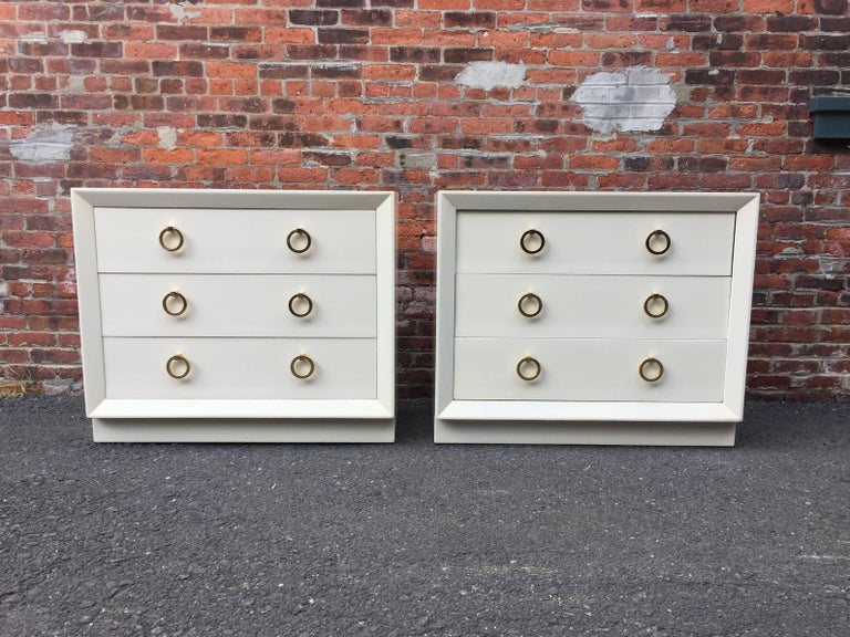 Pair of Terence Harold Robsjohn-Gibbings (1905-1976) dressers for Widdicomb. Deep three drawers with solid brass ring pulls. Plinth base with beveled front edge detail. Small hidden compartment under top drawer for securing valuables, etc. Paper