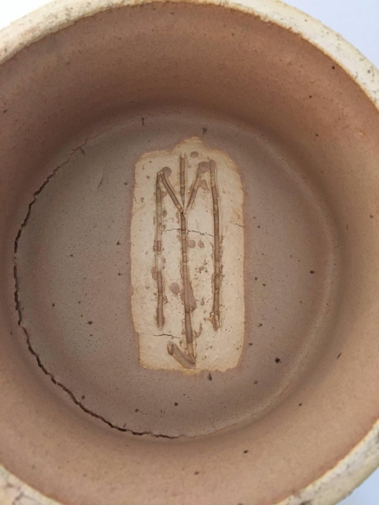 Signed John Masson lidded vessel with in the round carved wheat design. Hand thrown and fired stoneware.  14.5