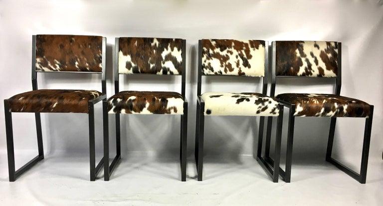 Fantastic set of four custom upholstered pony skin chairs, with hand blackened steel base by Brooklyn base furniture Designer Uhuru.