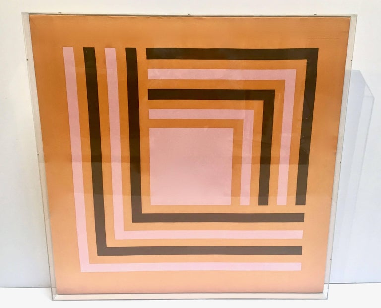 A great hard edge graphic abstract vintage silk scarf, circa 1970s. The scarfs design of interlocking lines and a square, reminiscent of Albers or Gene Davis, circa 1970s has vivid contrasting colors of orange, pink and deep chocolate brown. The