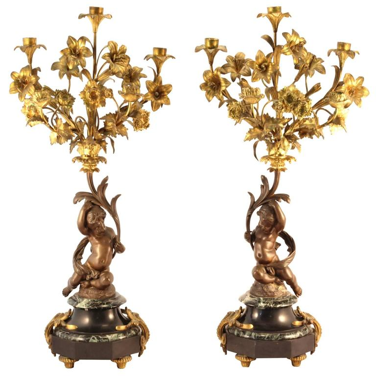 Pair of 19th Century Louis XVI Style Gilt and Cast Bronze Putti Candelabra For Sale