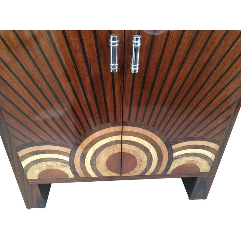 """Art Deco Cocktail Cabinet, Dry Bar, the front in multiple concentric circles of inlaid coloured Fruitwoods forming a large , central """"Bullseye"""" across the doors, at the bottom, with identical part """"Bullseyes"""" adjoining on left and right. From these"""