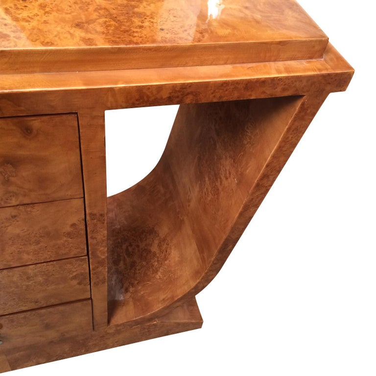 Art Deco design console table in burl Amboyna wood with 4 drawers to a central column in rectangular form. The top has also a large stepped edge to the front and the 2 sides. The 4 drawers, each with a central, mushroom shaped nickel handle. The