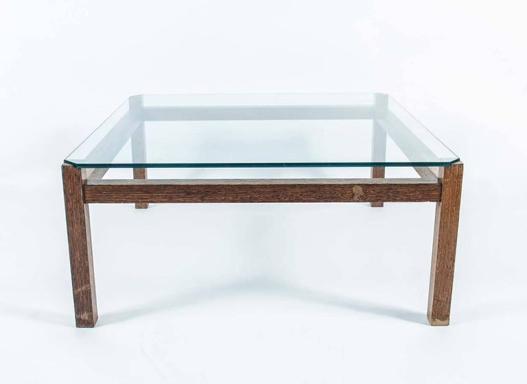 Midcentury Wengé and Glass Coffee Table designed by Kho Liang Ie for Artifort. This coffee table with its wengé frame and glass top was created by Kho Liang Ie, a Dutch-Indonesian designer best known for his design of the Schiphol Amsterdam Airport