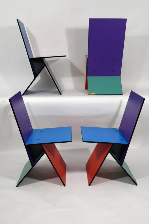 Set of four rare Vilbert Chairs designed in 1993 by Verner Panton for Ikea. Only about 4,000 of these chairs were manufactured.  The chairs consist of four multi-colored MDF boards screwed together.  Vilbert came in two color schemes: Three of