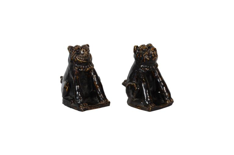 Rare pair of Japanese Folk Art Seto pottery shishi Buddhist guardian dogs glazed in a dark greenish brown toned glaze, late Meiji period  Acknowledged fault: numerous minor firing cracks across surface of both figures, with one large firing crack