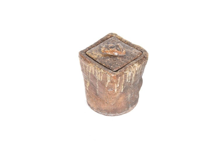 Antique Japanese Shigaraki pottery Mizusashi (water container) with rough and raw finish. Japanese Mizusashi are used to store water during tea ceremony and this is a fantastic example of the wabi-sabi philosophy of appreciating natural forms with