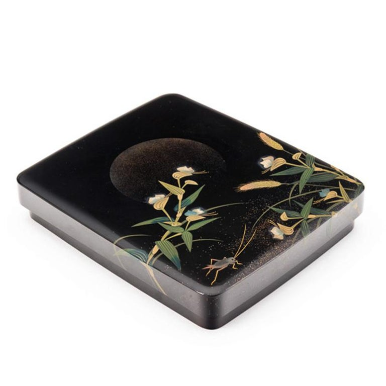 Japanese black lacquer Tsuzuri-Bako (writing box) with a delicate and whimsical design of a cricket and grasses illuminated by the gentle gaze of the full moon, circa 1960.