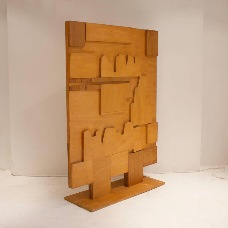 A double sided screen of layered plywood cut to create abstract designs in an Art Deco style, mid-20th century European, possibly German. The piece is in good original condition, with some signs of the artist's workings - including pencil and ink