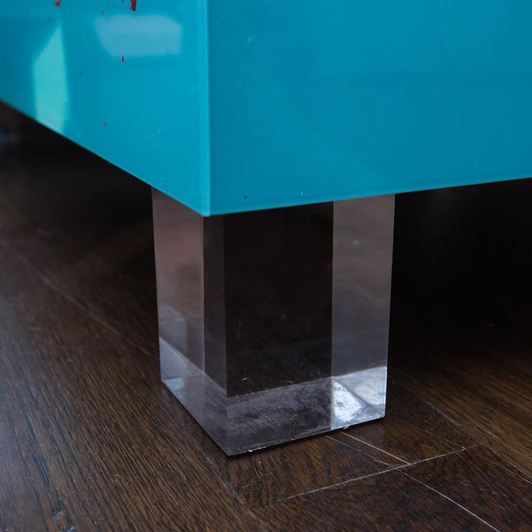 Custom, one-of-a-kind coffee table made of reverse drip-painted Lucite panels sitting on solid Lucite feet.