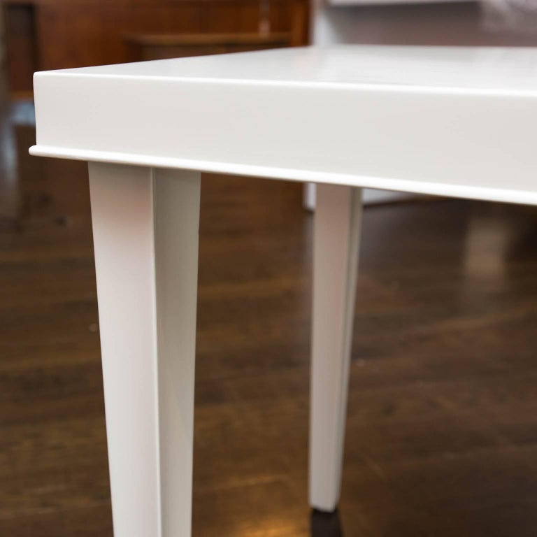 Simple, tapered leg side table that has been freshly lacquered in white dove gloss.