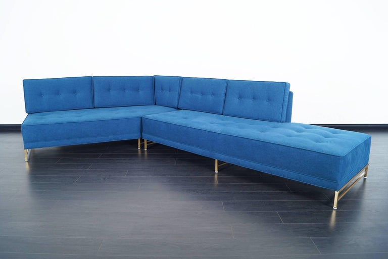 Stunning two-piece sectional sofa designed by Paul McCobb for Directional. Features a solid brass base. Fully restored.