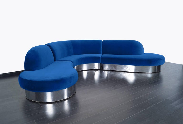 Stunning chrome curved sectional sofa designed by Milo Baughman for Thayer Coggin. Retains original manufacture label. Newly reupholstered in royal blue velvet.