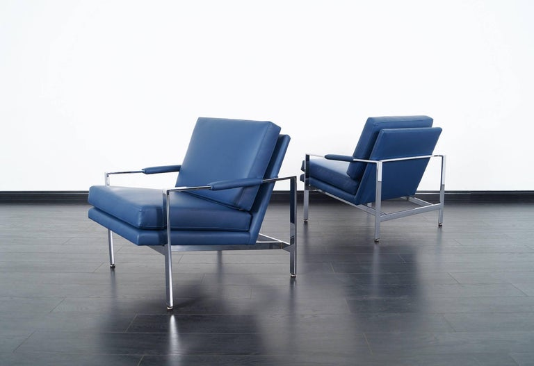 Amazing pair of vintage chrome lounge chairs designed by Milo Baughman for Thayer Coggin. Newly reupholstered in fine leather.