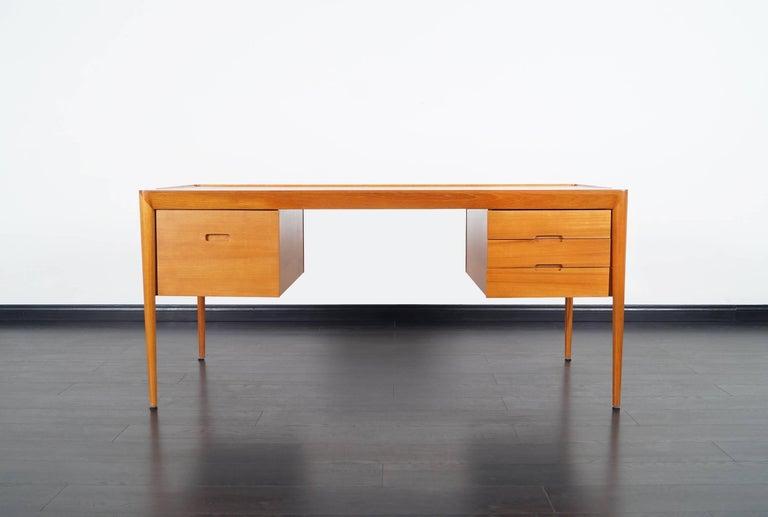 Stunning rare danish teak desk designed by Erik Riisager Hansen for Haslev Mobelsnedkeri in Denmark.