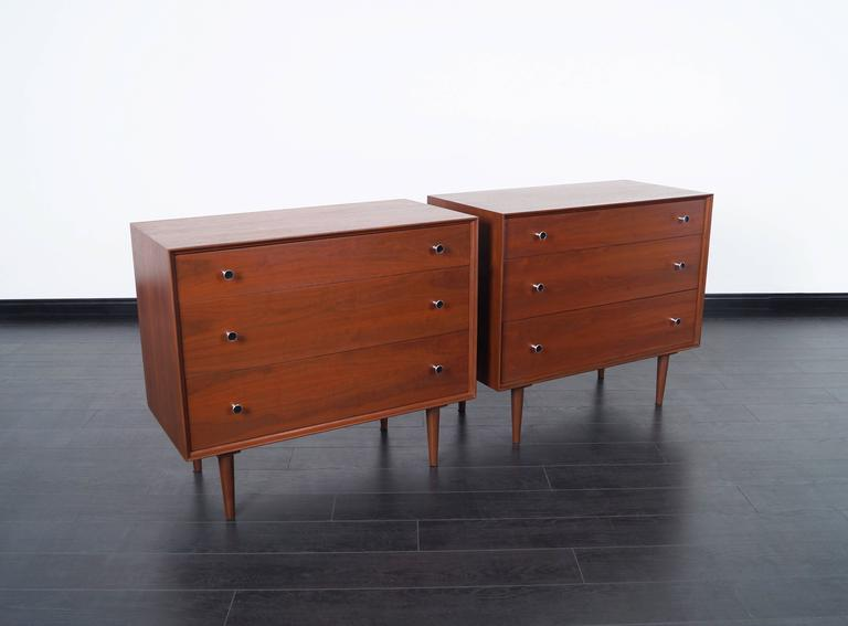 A wonderful pair of vintage chest of drawers designed by Robert Baron for Glenn of California. Each chest has three drawers with original aluminum pulls.