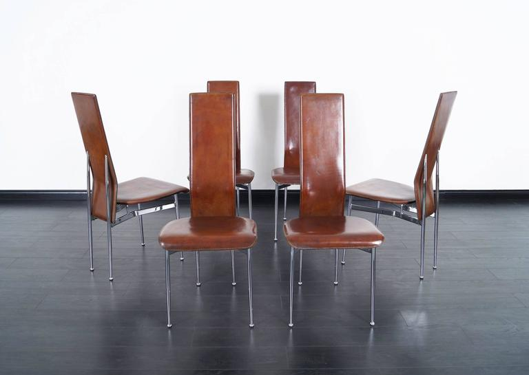 A Set Of Six Italian Chrome Dining Chairs With Original Distressed Leather.