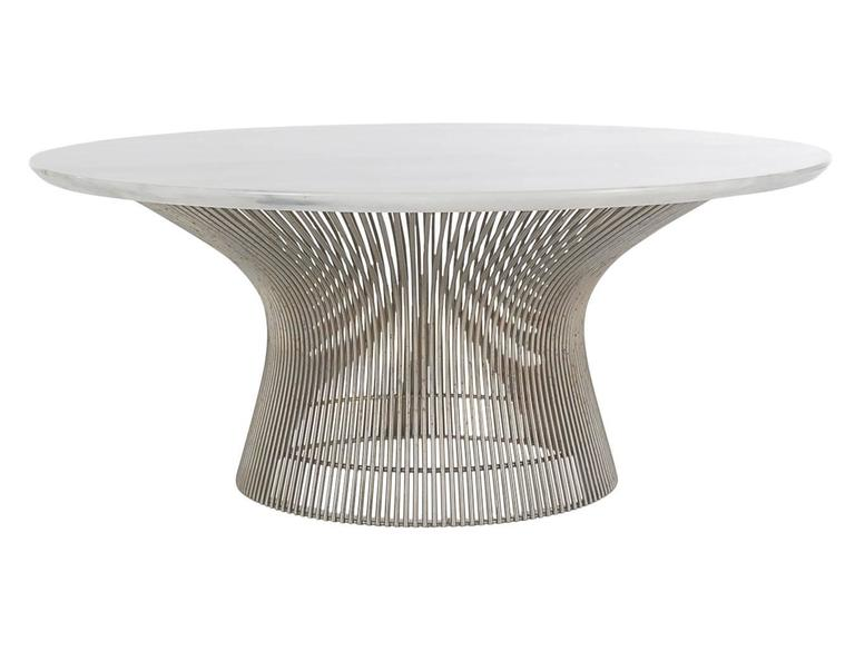 A classic design from one of the masters. This circa 1960's cocktail table features a sculptural wire base with heavy marble top.