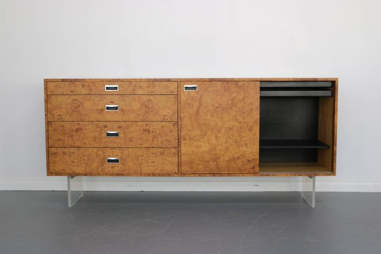 Sleek and elegant, this credenza was custom ordered in 1972 and is as lovely as ever! Left side contains four drawers, centre has two small hidden drawers and one adjustable shelf and right side has two hidden drawers and two adjustable shelves.