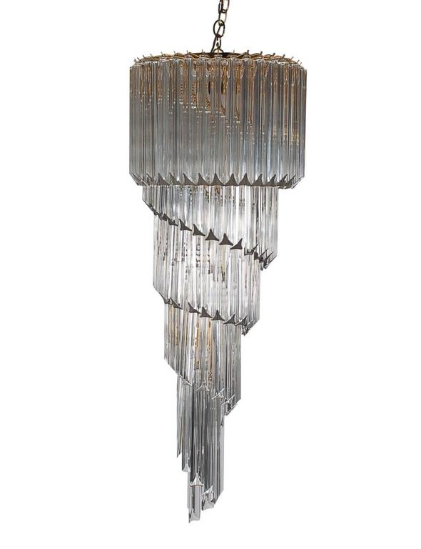 A large and impressive Italian spiral chandelier produced by Camer in the 1970s. It features gold-plated brass framing with crystal glass prisms in a spiral form. Tested and working. Marked: Made in Italy.