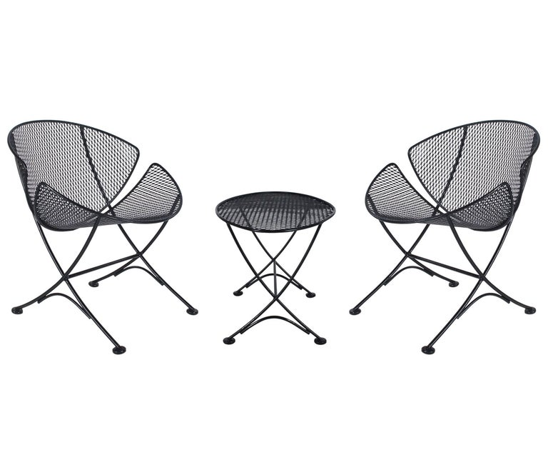 "A fine outdoor patio suite designed by Maurizio Tempestini and manufactured by Salterini in the 1950s. It features two ""Clam Shell"" lounge chairs along with a small cocktail table. All in excellent condition. Table measures W 17, H 17, D 26."