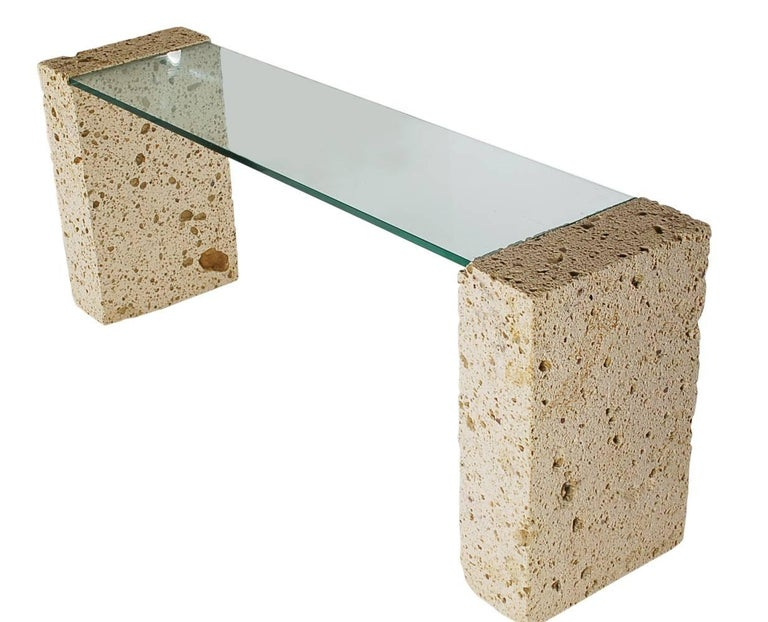 An incredible and organic statement piece. This console table, narrow desk, or sofa table consists of two large pieces of cut coral with a thick inlaid floating glass top. Absolutely stunning piece. 