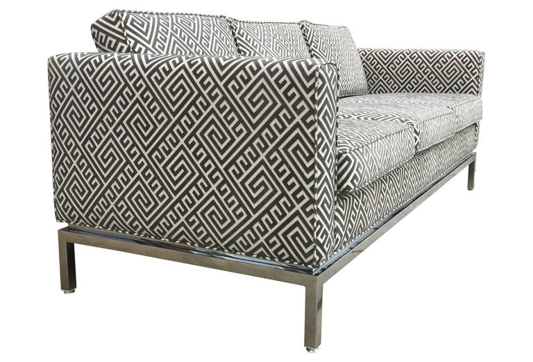 This vintage sofa has been lovingly restored and upholstered in a smoky grey cut velvet featuring a Greek key pattern. Mid mod meets Hollywood Regency meets 70's glam!