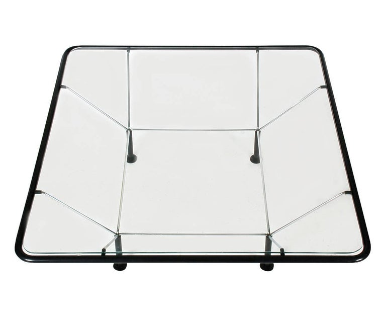 An architectual looking cocktail table very reminiscent of Paolo Piva's Alanda table. It features steel wire construction with black tubular plastic and inlayed clear glass, circa 1980s.