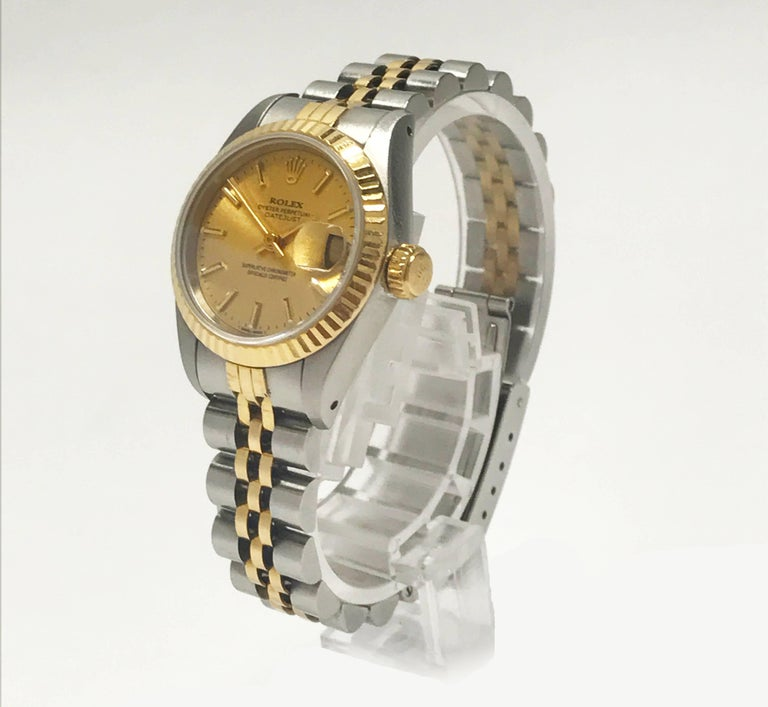A beautiful ladies estate watch made by Rolex and produced in the 1980's. A timeless and iconic DateJust featuring a two-tone stainless and 18K yellow design. It has a fluted bezel, champagne gold dial, and adjustable jubilee bracelet. Case diameter