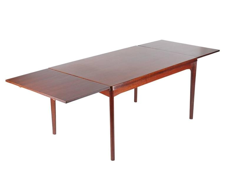 Scandinavian Modern Mid-Century Modern Danish Rosewood Dining Table, Henning Kjaernulf For Sale