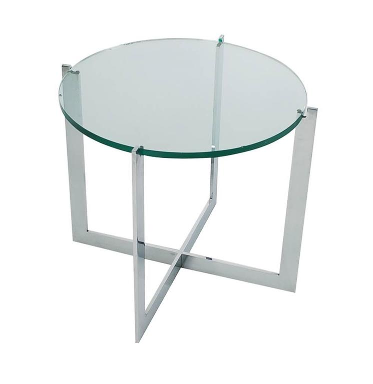 A Classic X base designed table by Milo Baughman and produced by Thayer Coggin. It features a heavy solid chrome flat bar base with a floating glass top.