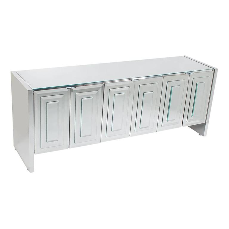 A chic and glamorous mirrored six-door cabinet made by Ello. It features Art Deco mirror stacked doors with chrome trim. Interior is off-white laminate.   In the style of: Pierre Cardin, Mastercraft, Paul Evans.