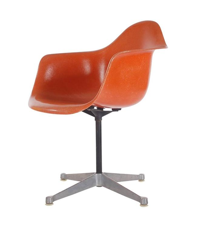 Here we have an iconic design classic from the Mid-Century Modern period. This vintage fiberglass shell chair was designed by Charles Eames and produced by Herman Miller, circa 1972. I have a great iconic retro orange. These chairs are sold with