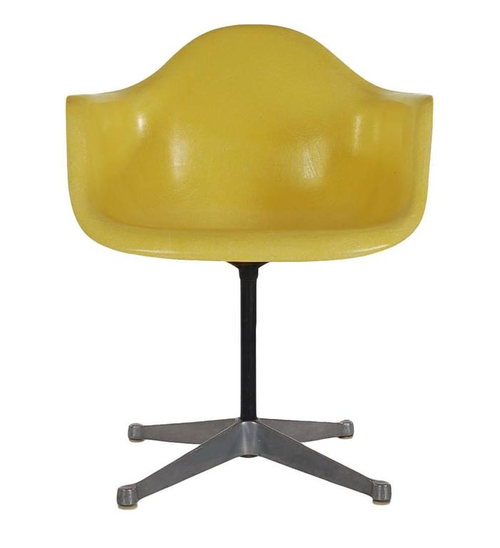Here we have an iconic design Classic from the Mid-Century Modern period. This vintage fiberglass shell chair was designed by Charles Eames and produced by Herman Miller, circa 1972. Great mix of hard to find colors, navy, chocolate, terracotta, and