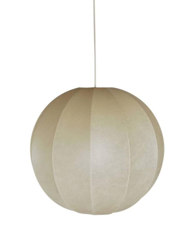 A simple modern beauty designed by Achille and his brother Pier Giacomo Castiglioni. Its made of a very soft skin like plastic stretched over a metal frame. This is the largest size made. Very similar design to the bubble lamp by George Nelson. It